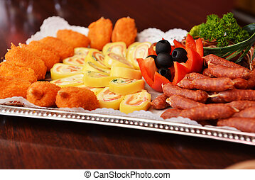Beer snack with grilled meat, wienerwurst  and vegetables