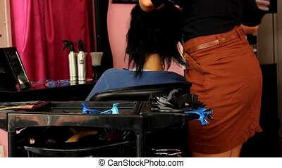 Hair-stylist in hairdressing salon