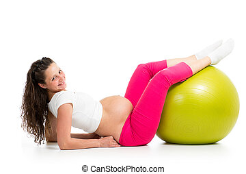 Pregnant woman excercises with gymnastic fit ball - Pregnant...