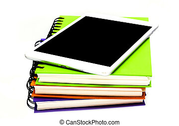 stack of ring binder book or notebook with tablet computer...