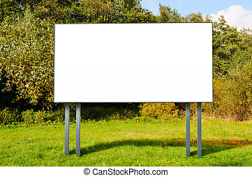 Empty billboard standing in a field - Billboard with empty...