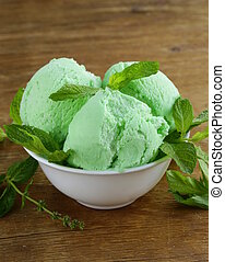 balls mint ice cream with fresh green herb