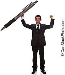 Business man celebrating holding a huge pen