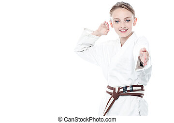 Young confident karate kid posing - Young karate fighter in...