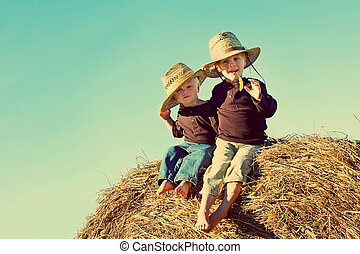 Little Country Boys on Farm - Two children, a young boy and...