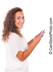 Happy woman texting on her phone isolated over white...