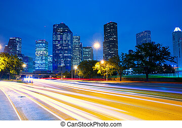 Houston Texas skyline at sunset with traffic lights -...