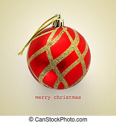 merry christmas - a red and golden christmas ball and the...