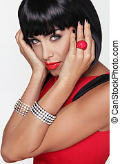Sexy beauty brunette woman. Makeup. Stylish Fringe. Black Short Hair Style. Jewelry. Fashion photo