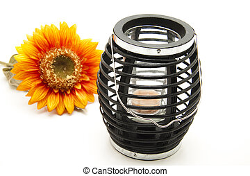 Tea light with sunflower on white background