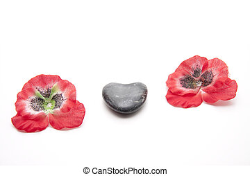 Heart stone with flower blossoms on white background