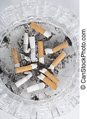Background Ashtray full of used Cigarette Butts