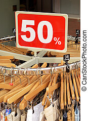 Fashion outlet - Sale in a clothing store - 50 discount sign...