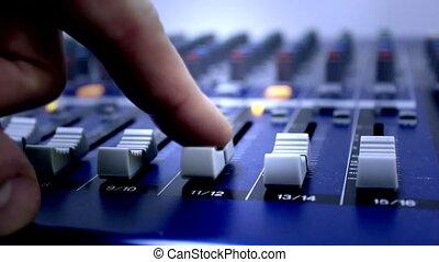 sound mixer and sliders  in recording studio