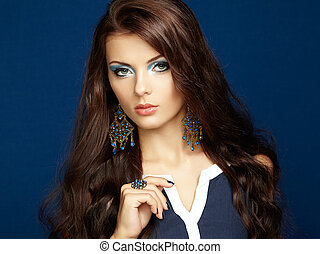 Portrait of beautiful brunette woman with earring Perfect...