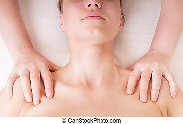 Therapist doing shoulders massage and pressing points to...