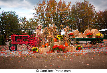 Old Farm Tractor - Old tractor as fall harvest decor in yard