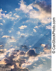 Heavenly Cloudscapes - Suns rays beaming from behind clouds