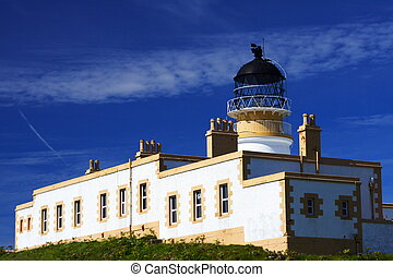 Neist point lighthouse under a blue summer sky, isle of...