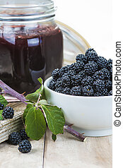 Blackberry jam - A pot with blackberry jam and some fresh...