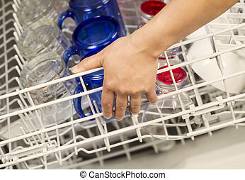 Closing Dishwasher rack filled with Glassware