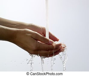 Water pouring into hand and splashing
