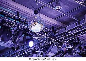 Mirrored Ball in Theater Under Purple Lights - Mirrored ball...