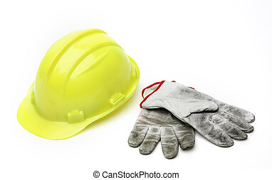 Yellow hardhat and old gloves isolated on white background
