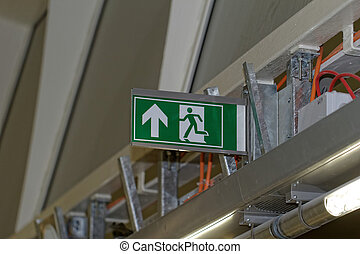 Emergency exit sign in construction site an industrial plant