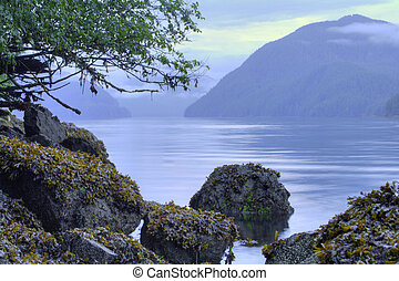 Silver Bay - Picturesque seascape and rocky shoreline of...