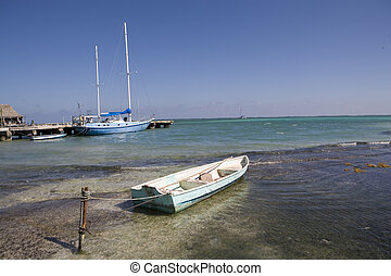 Small boat tied to a stake - A small boat is tied to a metal...
