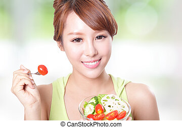 attractive woman smile eating salad - portrait of attractive...