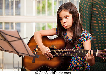 Learning how to play the guitar - Pretty little brunette...