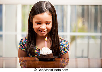 Little birthday girl with a cake