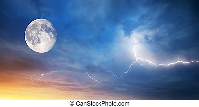 Moon and lightning on sunset.Composition of nature.