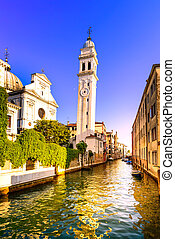 Venice sunset cityscape, San Giorgio dei Greci water canal and church campanile. Italy, Europe.