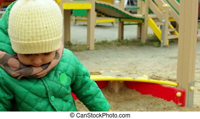 Playing with sand - Cute kid playing in the sandbox together...