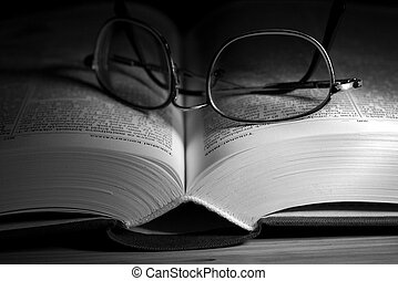 Open Book - Open book in black and white with glasses on it
