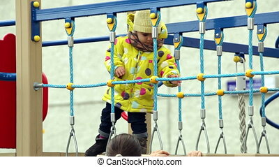 On the bridge - Child full of energy playing on the bridge...