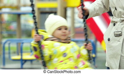 Swing ride - Little cutie enjoying a swing ride on the...