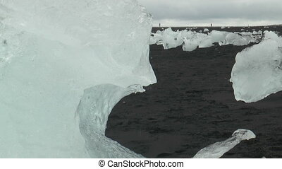 isolated iceberg on sand beach melt - isolated iceberg on...
