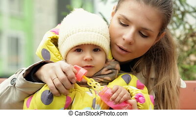 Autumn soap bubbles - Charming cutie and her mommy playing...
