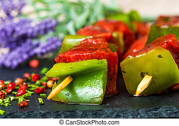 tasty meat and vegetables skewers on a slate plate