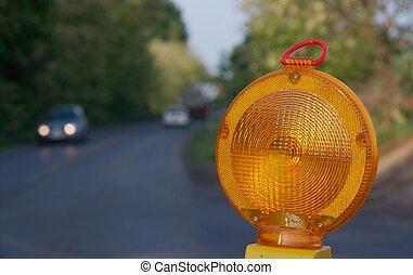 Warning - Yellow warning light at a road construction