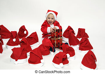 child with christmas gifts - blond girl with christmas...