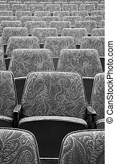 thin theatre - empty wooden cinema or theater seats, black...