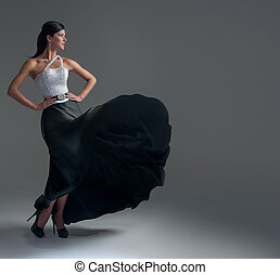 girl dances in a black silk skirt