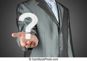 Businessman with question mark on dark background