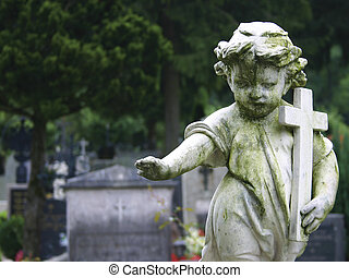 Stone Statue Child - Stone statue of a child holding a cross...