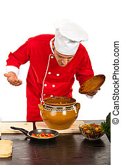 Chef smelling food against white background